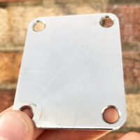 Unbranded 4 bolt neck plate. Fits perfectly on Fender guitars - $5